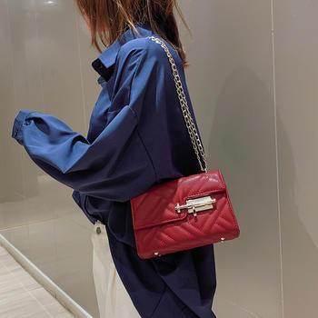 雅诗罗时尚菱格绣线插锁单肩包