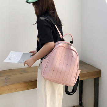 雅诗罗韩版新款铆钉休闲双肩背包女百搭潮流双肩包