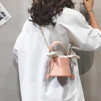 雅涵韩版时尚可爱兔耳朵手提女包单肩斜挎水桶包包
